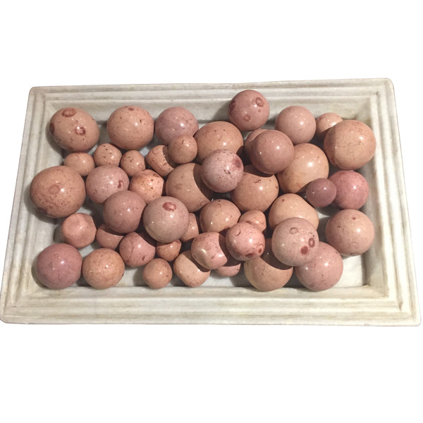 Collection Of Rose Colored Stone Balls